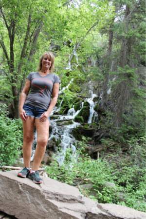 uterine fibroids | CU Medicine OB-GYN East Denver (Rocky Mountain) | patient Lisa poses by waterfall