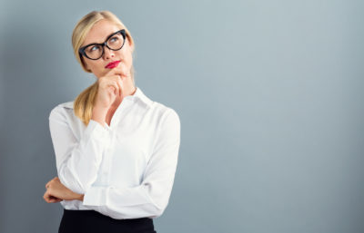 birth control methods | bespectacled woman thinking | CU Medicine OB-GYN East Denver (Rocky Mountain)